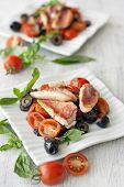 stock photo of mullet  - Cookied red mullet with tomato back olives and basil - JPG