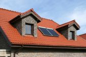 foto of red roof tile  - Beautiful new home with solar panels on the roof  - JPG