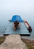 stock photo of pontoon boat  - Wooden boat house in the early morning with fog - JPG