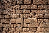 Wall made of bricks made of lava