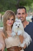 young couple with pet maltese dog