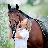 foto of saddle-horse  - Woman hugging a horse - JPG