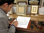 ESFAHAN, IRAN - DECEMBER 01, 2007:  Iranian calligraphy artist at work  traditional Persian art of d