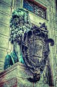 foto of munich residence  - Vintage retro hipster style travel image of Bavarian lion statue at Munich Alte Residenz palace in Odeonplatz with overlaid grunge texture - JPG