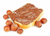 stock photo of chocolate fudge  - Bread with sweet chocolate hazelnut spread isolated on white - JPG