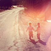 picture of girl walking away  - Two girls holding hands walking on road  - JPG