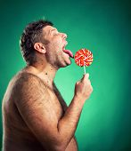 foto of pervert  - Shirtless man licking candy - JPG