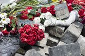 image of barricade  - Flowers on the barricades of Kiev in place of death during a riot in February 2014 during the political crisis in Ukraine - JPG