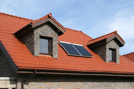 picture of red roof  - Beautiful new home with solar panels on the roof  - JPG