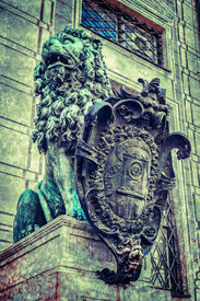 stock photo of munich residence  - Vintage retro hipster style travel image of Bavarian lion statue at Munich Alte Residenz palace in Odeonplatz with overlaid grunge texture - JPG