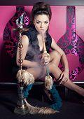 picture of hookah  - Beautiful woman smoking hookah in nightclub - JPG