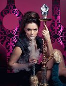 image of hookah  - Beautiful woman smoking hookah in nightclub - JPG