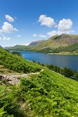 pic of haystack  - Buttermere English Lake District Cumbria England uk on a beautiful sunny summer day surrounded by fells including High Stile - JPG