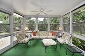 image of screen-porch  - Porch in suburban home with green flooring