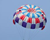 picture of parachute  - A colorful parachute with blue summer sky in the background - JPG