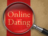 pic of divorce-papers  - Online Dating through Magnifying Glass on Old Paper with Red Vertical Line - JPG