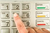 image of automatic teller machine  - Closeup of finger presssing number five in atm machine with metallic keyboard - JPG