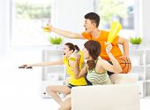 stock photo of yell  - young people so excited to yelling and while watching tv - JPG