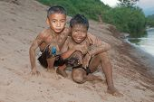 pic of ou  - Boy of Asia with sand in the face at Nam Ou River in Laos - JPG