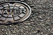 stock photo of manhole  - Water Manhole Outside in Hot Weather City - JPG