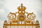 stock photo of versaille  - Golden arches on the entrance of Versailles palace in Paris France - JPG