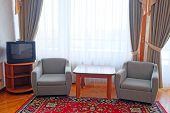picture of motel  - two chairs in the suite room at motel - JPG