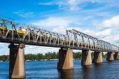 foto of railcar  - Petrivskiy railroad bridge in Kyiv across the Dnieper with freight train on it - JPG