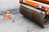 image of cone  - Road roller and traffic cone on the road construction - JPG
