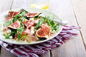 picture of rocket salad  - Rocket feta fig and prosciutto salad on plate - JPG