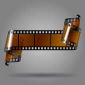 picture of strip  - Curled photo film strip on gray background - JPG