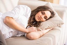 image of sweet dreams  - Beautiful young woman is sleeping and seeing sweet dreams - JPG