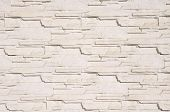 foto of tile cladding  - White cladding tiles imitating stones in sunny day - JPG