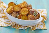 stock photo of baked potato  - Oven baked potatoes with rosemary in a baking dish - JPG