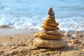 foto of freedom tower  - Stones balance and blue sea on defocused background with bokeh - JPG