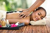 image of thai massage  - Young attractive woman enjoying in professional Asian massage back - JPG