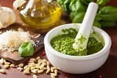 stock photo of pesto sauce  - pesto sauce and ingredients over wooden rustic background - JPG