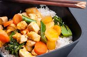 image of curry chicken  - Thai coconut and mango curry with diced chicken and sliced carrots over coconut rice - JPG