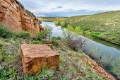 picture of horsetooth reservoir  - sandstone block and old sandstone quarry on lake shore  - JPG