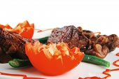 picture of veal  - served roast veal fillet on a white plate with tomatoes - JPG
