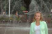 pic of gushing  - portrait of young pretty woman near city fountain - JPG