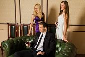 pic of threesome  - A guy and two girls in the room - JPG
