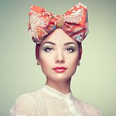 image of hair bow  - Portrait of beautiful young woman with bow - JPG