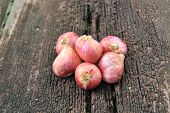 image of red shallot  - red shallots group on wood texture background - JPG