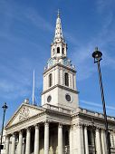 stock photo of church-of-england  - Designed by James Gibbs in 1721 St Martin In The Fields church stands in Trafalgar Square - JPG