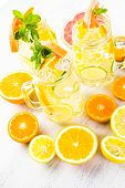 stock photo of infusion  - Infused water with fresh citrus fruits and ice. ** Note: Shallow depth of field - JPG