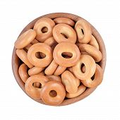 picture of bagel  - Bagels in a wooden bowl isolated on a white background - JPG