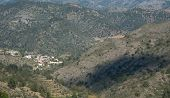 pic of mountain-range  - Mountain village of Askas in a valley formed by the mountains of the mountain range of Troodos in Cyprus - JPG