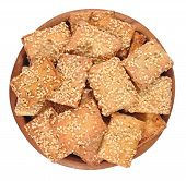 picture of sesame seed  - Cookies with sesame seeds in a wooden bowl on a white background - JPG