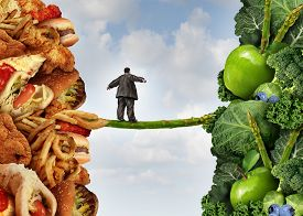 stock photo of fruits  - Diet change healthy lifestyle concept and having the courage to accept the challenge of losing weight and fighting obesity and diabetes as an overweight person walking on a highwire asparagus from fatty food towards vegetables and fruit - JPG