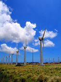 stock photo of wind energy  - large wind mills at a farm in hawaii - JPG